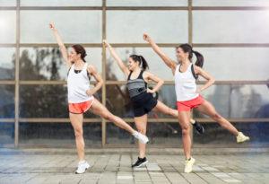 Athlete girls training aerobic outdoor